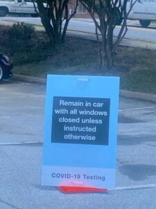 COVID-19 sign at drive-thru testing site, Forest Park, GA