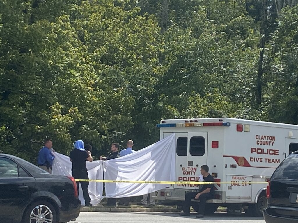 Clayton County Police five team recovering a body from the Flint River