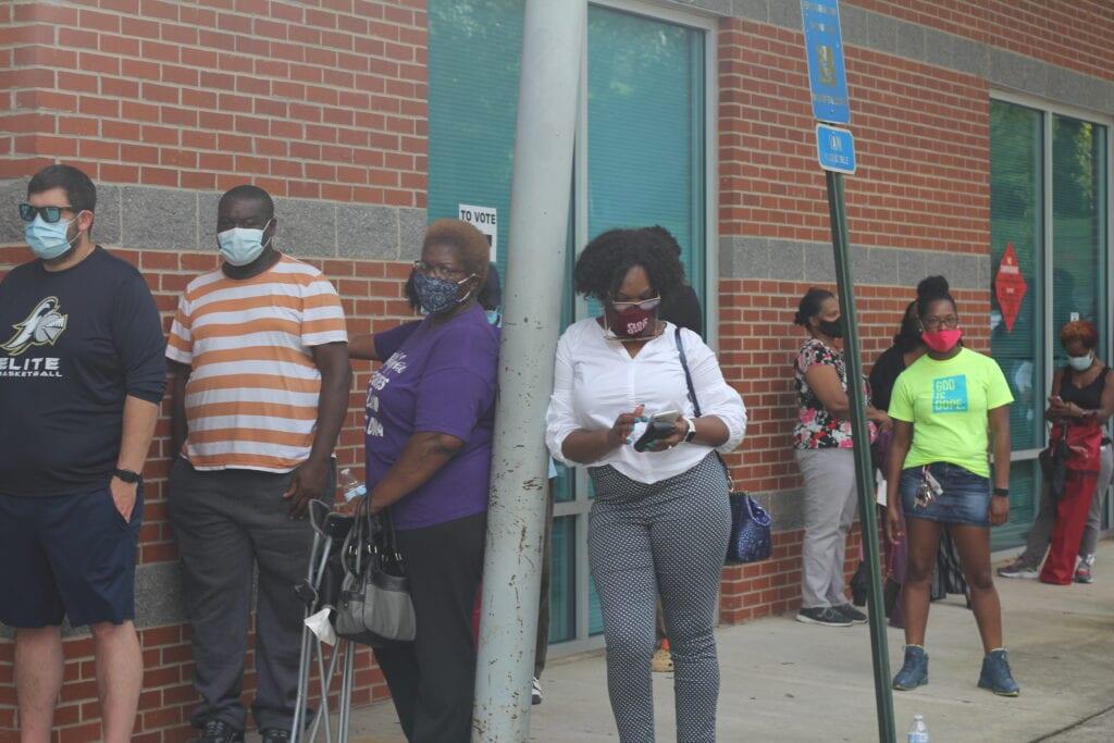 Voters wait in line at Carl Rhozenizer Rec Center, Rex, GA, Oct. 11, 2020