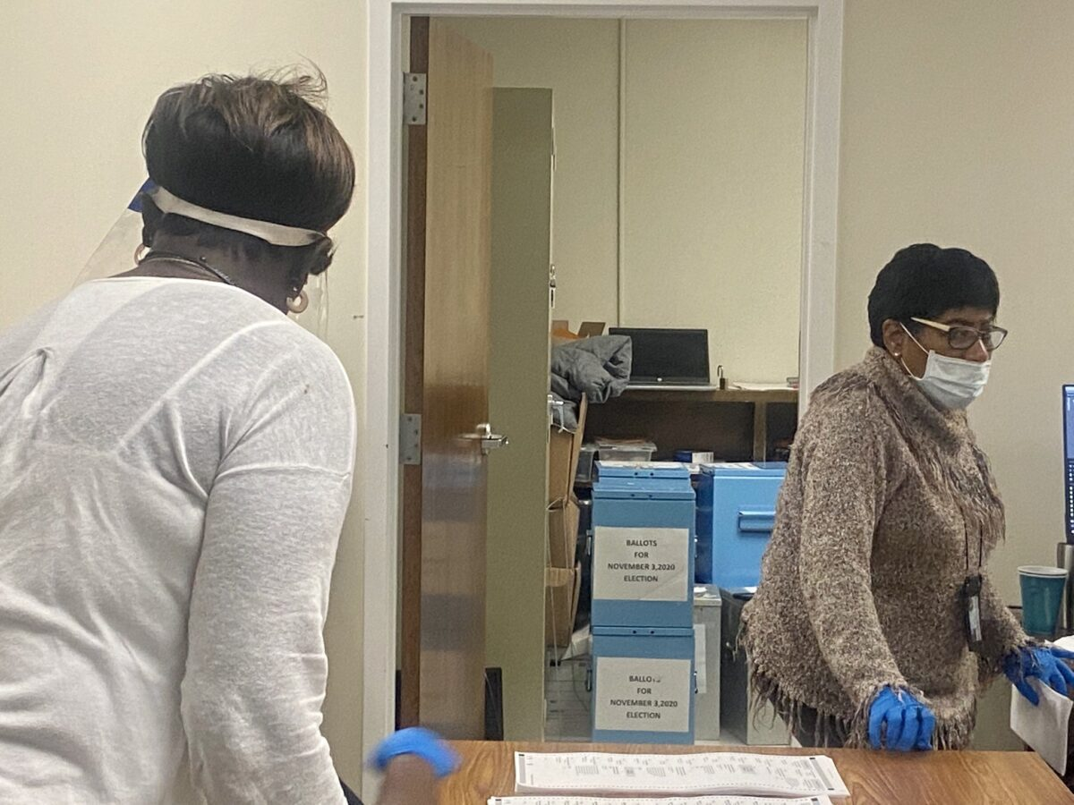 Clayton County, GA elections workers with ballot boxes, Nov. 6, 2020 (C) Robin Kemp, claytoncrescent.org