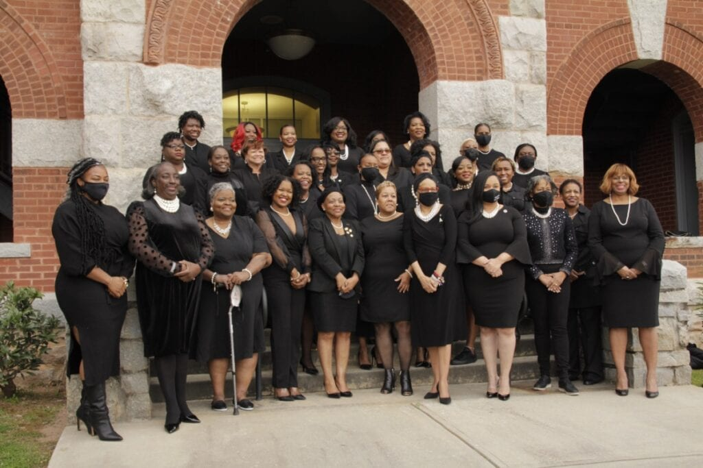 Most of the 40 Black female elected officials in Clayton County pose for a group photo on the steps of the Historic Courthouse in Jonesboro, GA, March 6, 2021.