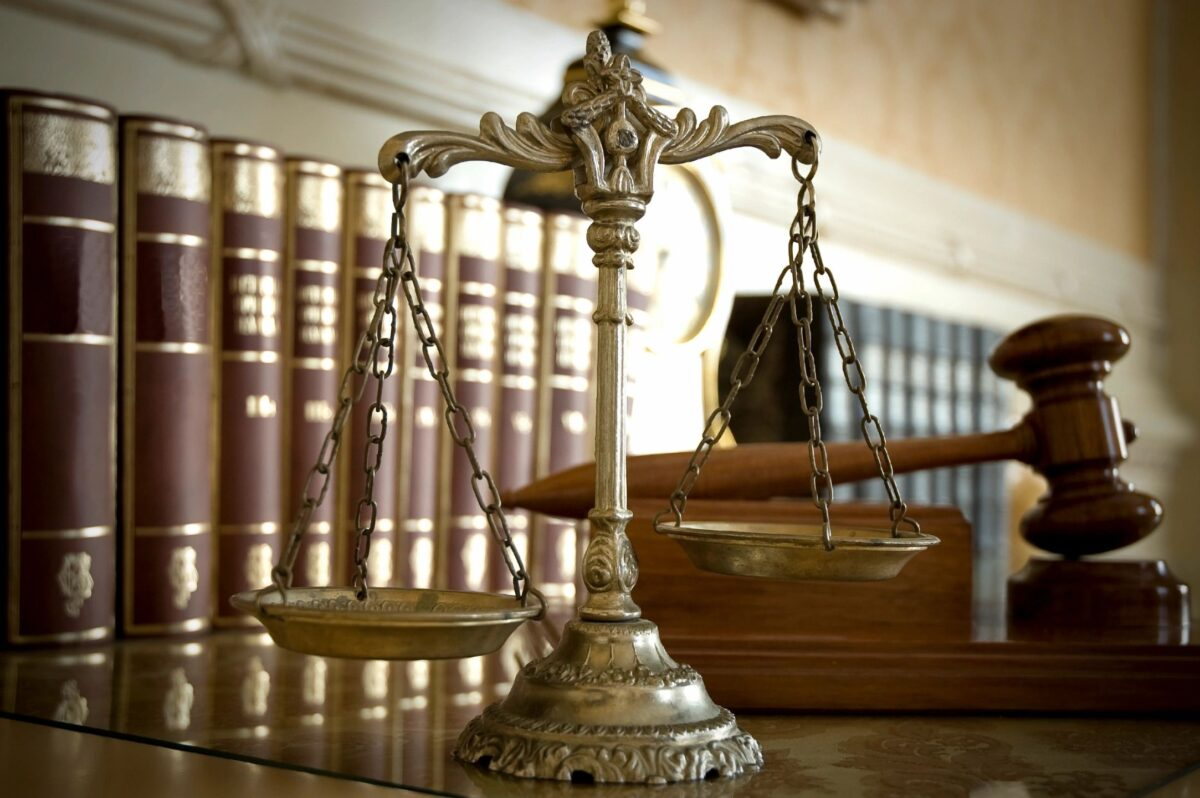 law books, scale, gavel
